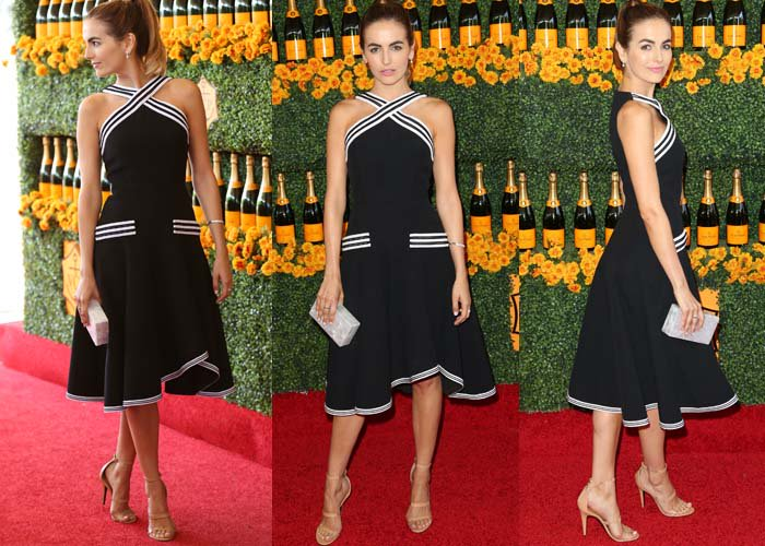 "Camilla Belle graced the red carpet looking très belle in a halter dress by Andrew Gn, which she paired with a rectangular clutch by Edie Parker and the ""Frontline"" sandals by Tamara Mellon in nude"