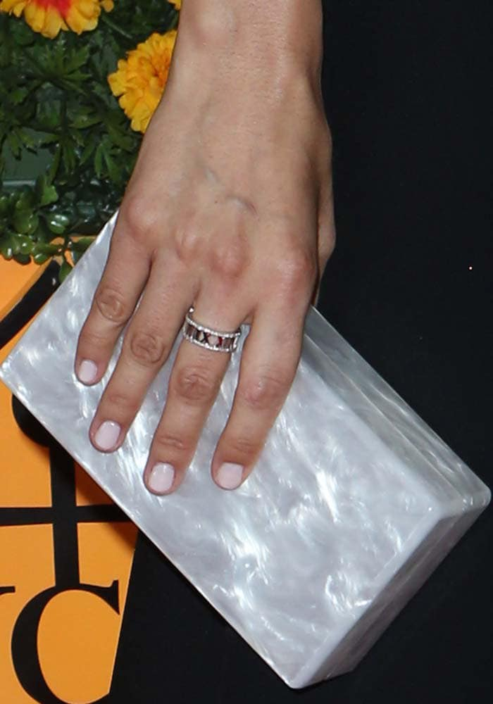 Camilla Belle showed off a rectangular clutch by Edie Parker