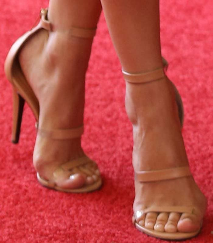"Camilla Belle wearing ""Frontline"" sandals by Tamara Mellon in nude"