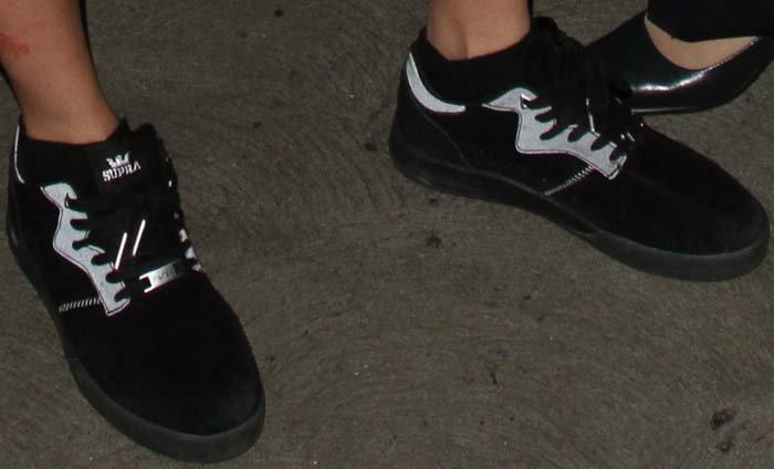 Cara Delevingne's feet in Supra Lucien Clarke x PWBC Quattro sneakers