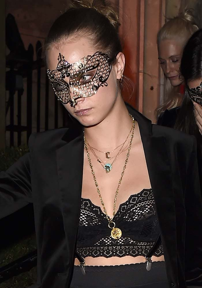 Cara Delevingne rocks Jennifer Fisher's iconic Double Small Gothic Letter necklace and a lacy bralette at Eva Cavalli's VIP birthday party