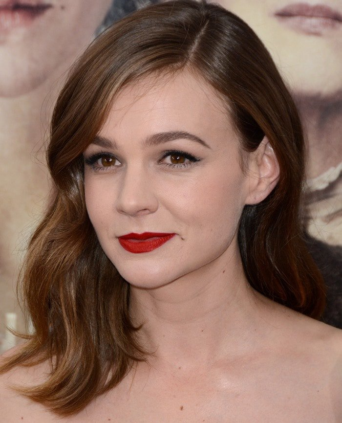 Carey Mulligan with a bold pop of color against her fair skin
