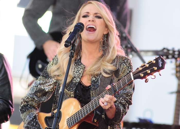 Carrie Underwood wears her long blonde hair down as she performs on the Today show