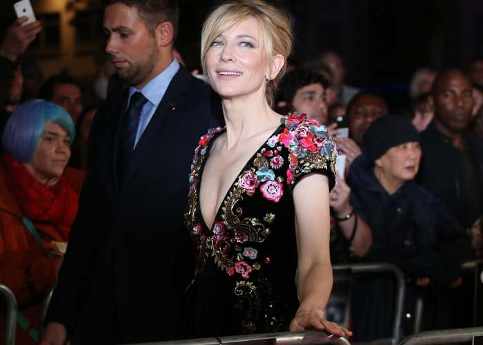 Cate Blanchett shows off her blonde hair and cleavage in a floral-and-sequin Schiaparelli gown