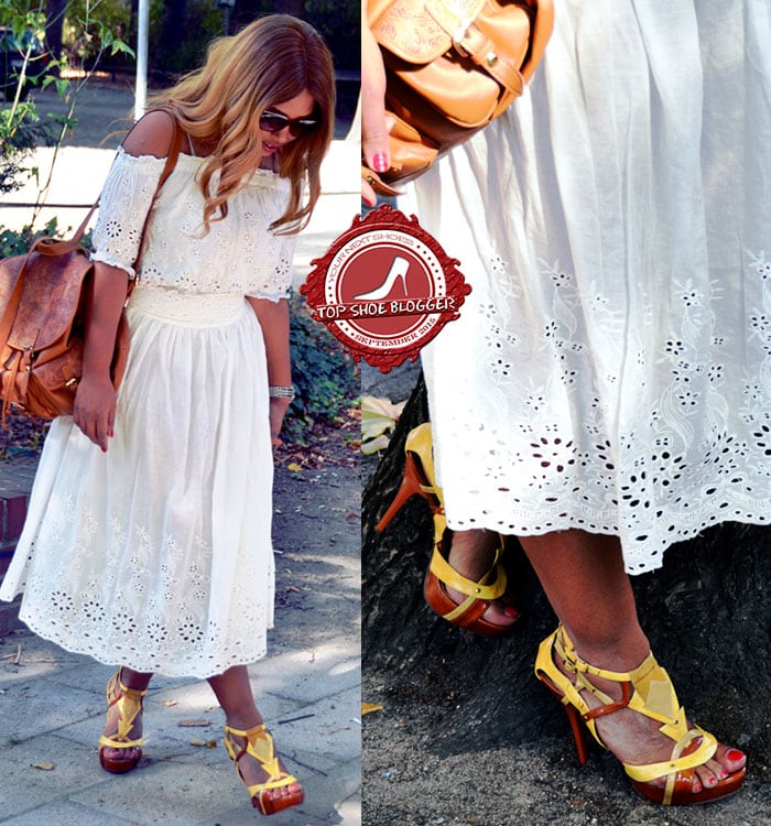 Chiara's yellow-and-burnt-orange shoes paired with a white dress