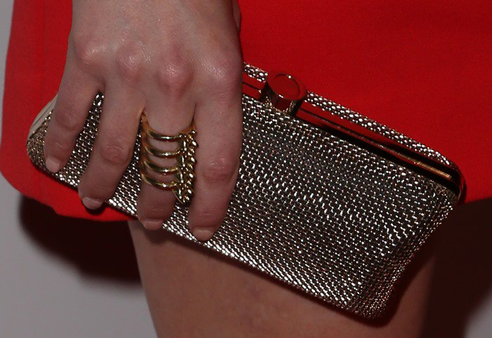 Elisabeth Moss accessorizes with a ring and a clutch