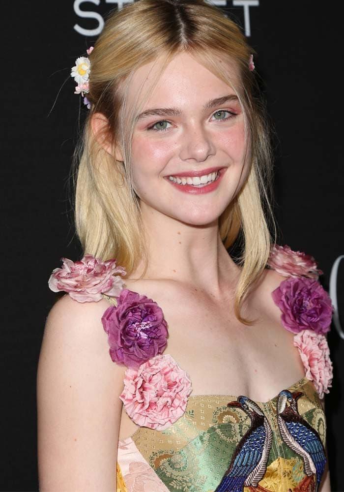 "Elle Fanning wears flowers in her hair at the U.S. premiere of ""Trumbo"""
