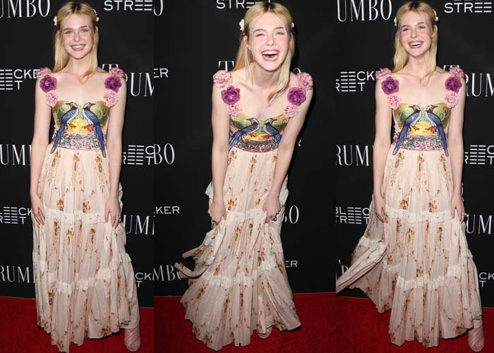 Elle Fanning giggles on the red carpet in a whimsical floral dress from Gucci