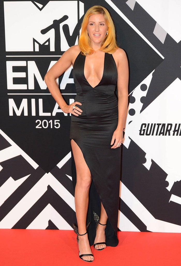 Ellie Goulding wearing a black satin dress by Alex Perry