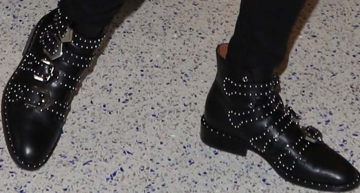 Emma Roberts wears a pair of studded Givenchy boots on her feet