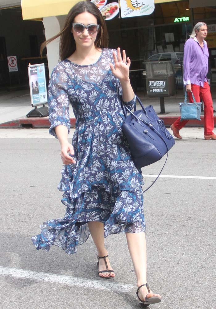 Emmy Rossum waves to paparazzi during a Beverly Hills shopping trip
