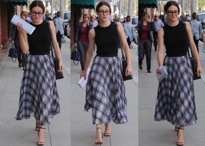 Emmy Rossum holds papers in one hand and carries a shoulder tote in Beverly Hills