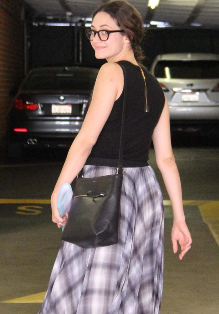 Emmy Rossum shows off her new Warby Parker glasses