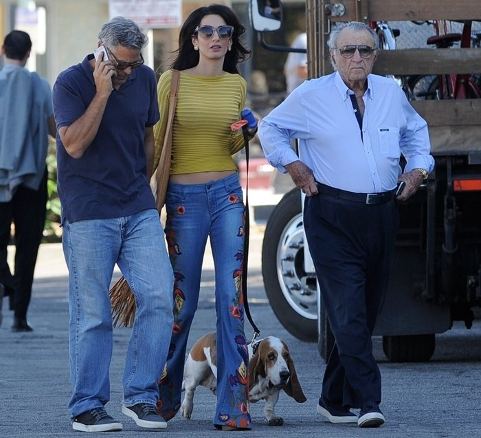 George Clooney shows his Shiite Muslim father–in–law Ramzi Alamuddin and his wife Amal Clooney around the set of 'Suburbicon'