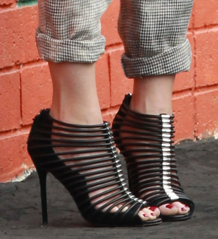 Gwen Stefani's feet in strappy sandals from her own L.A.M.B. line