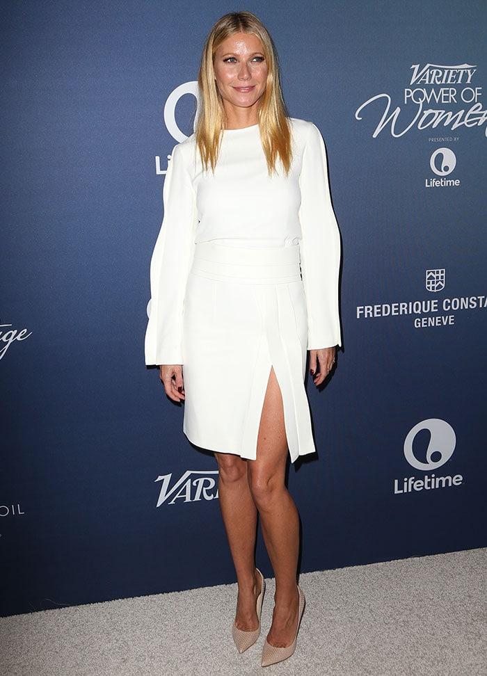 Gwyneth Paltrow flaunted her sexy legs inan elegant crisp white Brandon Maxwell ensemble