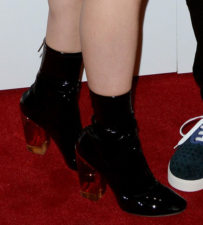 Hailee Steinfeld finishes her look with a pair of lucite-heel boots from Christian Dior