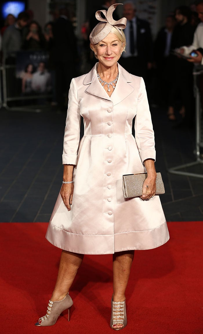 Helen Mirren's coat dress features a button-down front, cuffed long sleeves, and a flattering A-line silhouette