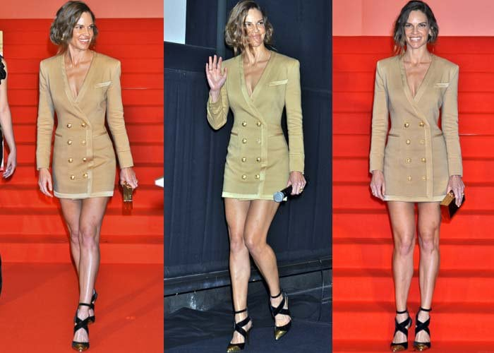 Hilary Swank waves to the cameras from the red carpet of the Tokyo International Film Festival