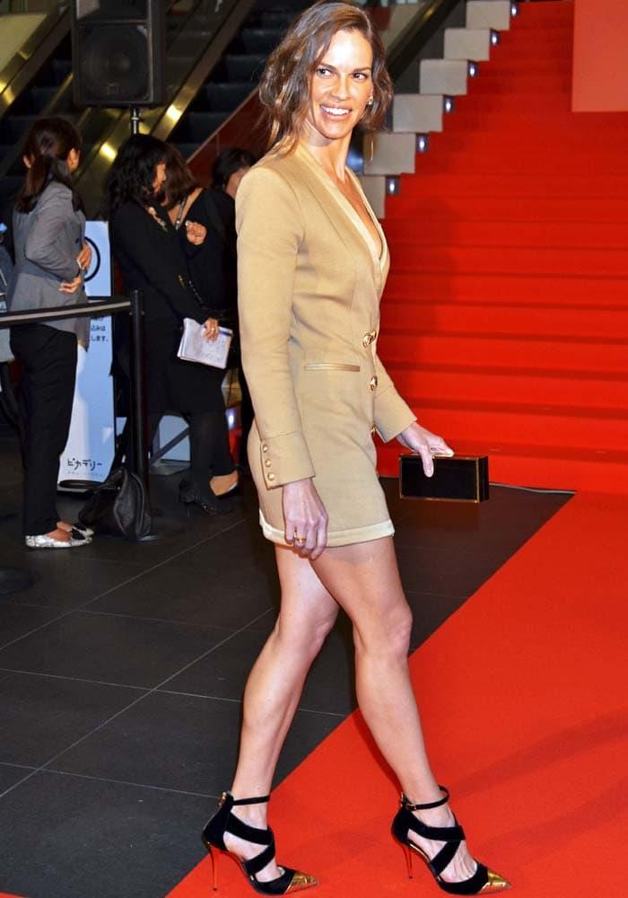 Hilary Swank shows off her legs in a tuxedo dress