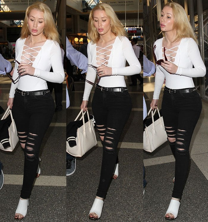 Iggy Azalea wears a pair of J Brand jeans and a Missguided bodysuit