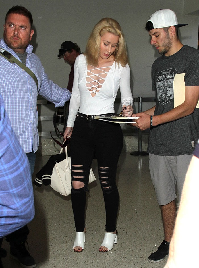 Iggy Azalea shows off her breast implants in a white Missguided bodysuit