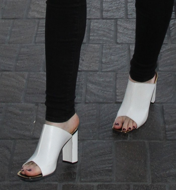Iggy Azalea's feet in a pair of white mules