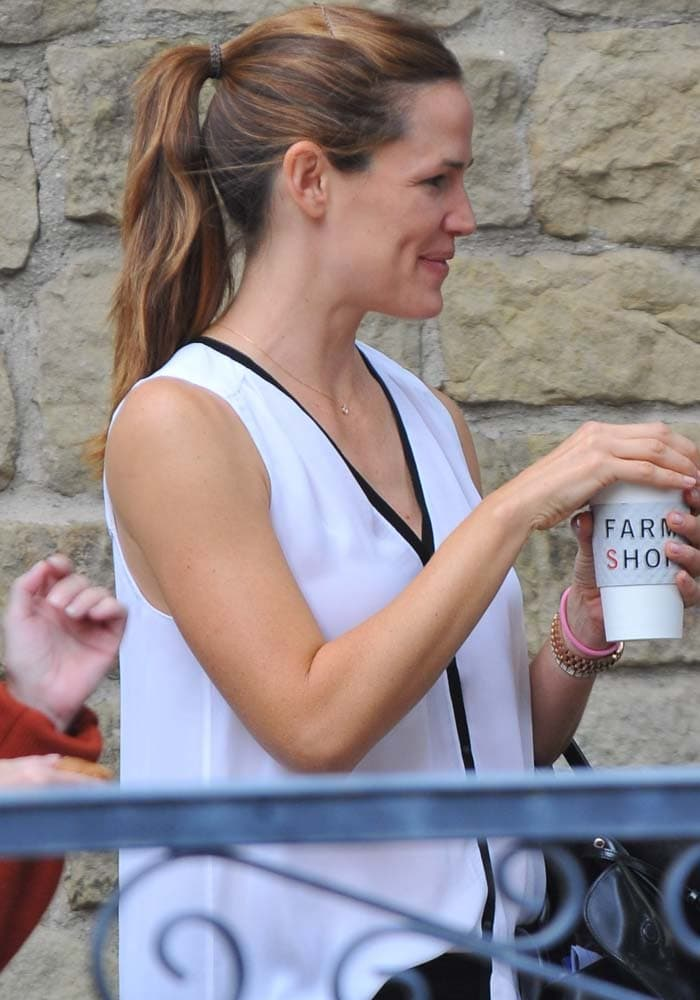 Jennifer Garner in a white silk top from Andrea Lieberman's A.L.C.