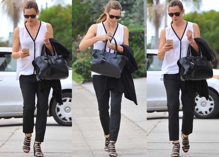 Jennifer Garner toting a black Tod's small cape bag