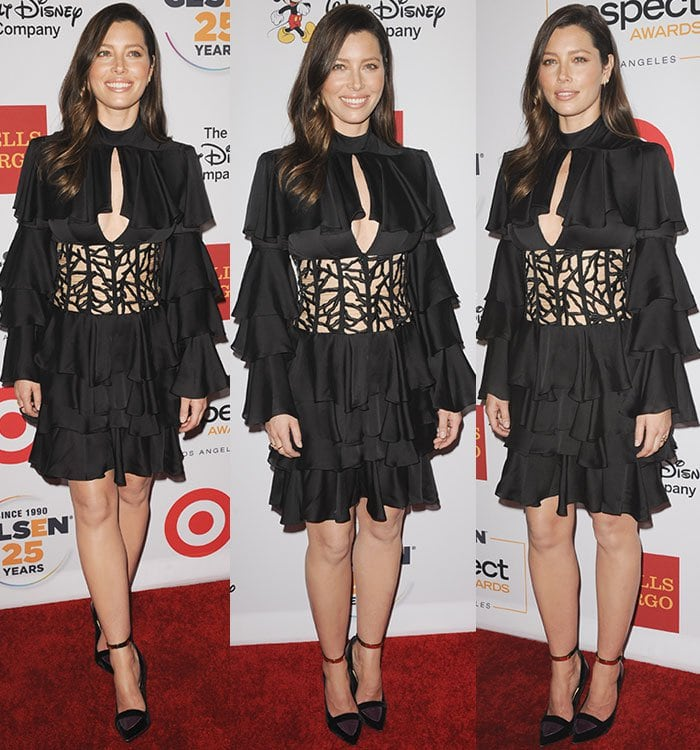 Jessica Biel smiles and poses on the red carpet in a Balmain ensemble