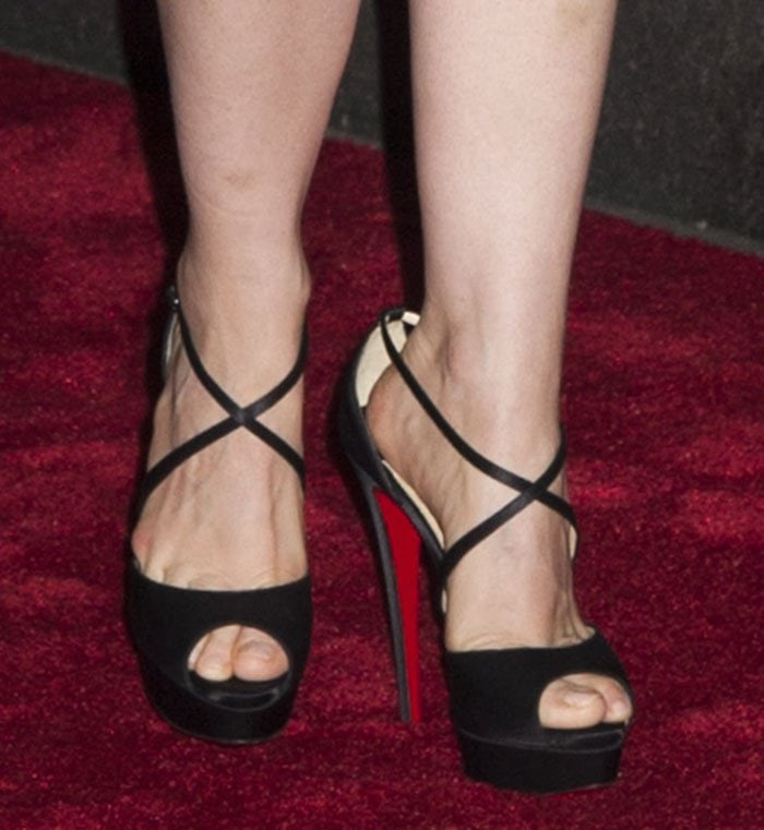Jessica Chastain wearing Christian Louboutin Cross Me sandals