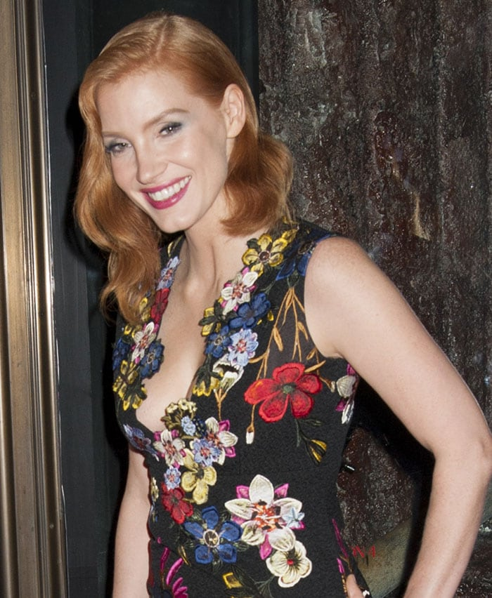 Jessica Chastain showed off ample cleavage in a figure-flattering mini dress from Erdem's Resort 2016 collection featuring a plunging neckline, floral appliques in multiple colors, and a ruffled hem that put her legs on display