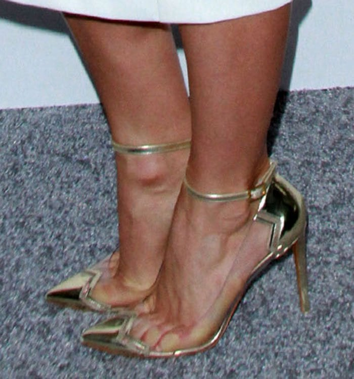 """Julianne Hough showing off her feet inNicholas Kirkwood """"Mirage"""" pumps in metallic gold leather with clear PVC panels"""