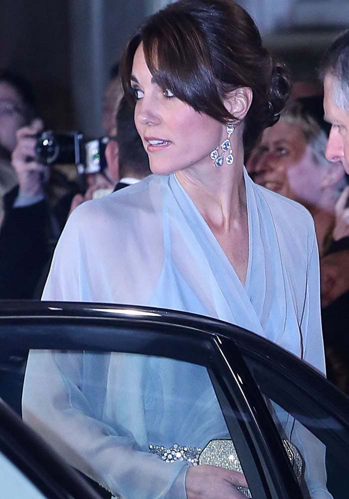 Kate Middleton coordinates her sparkly Jenny Packham clutch with the belt detailing on her dress