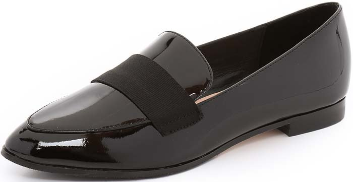 A grosgrain-ribbon accent crosses the vamp of a pointy-toe loafer for a feminine finish