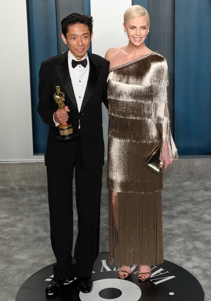 Kazuhiro Tsuji and Charlize Theron attend the 2020 Vanity Fair Oscar Party