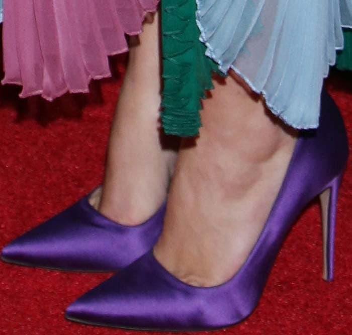 Keira Knightley's feet in purple satin pumps