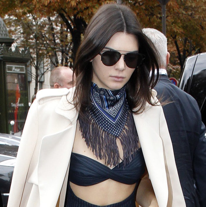 Kendall Jenner wears her hair down and accessorizes with a scarf as she heads out for lunch in Paris