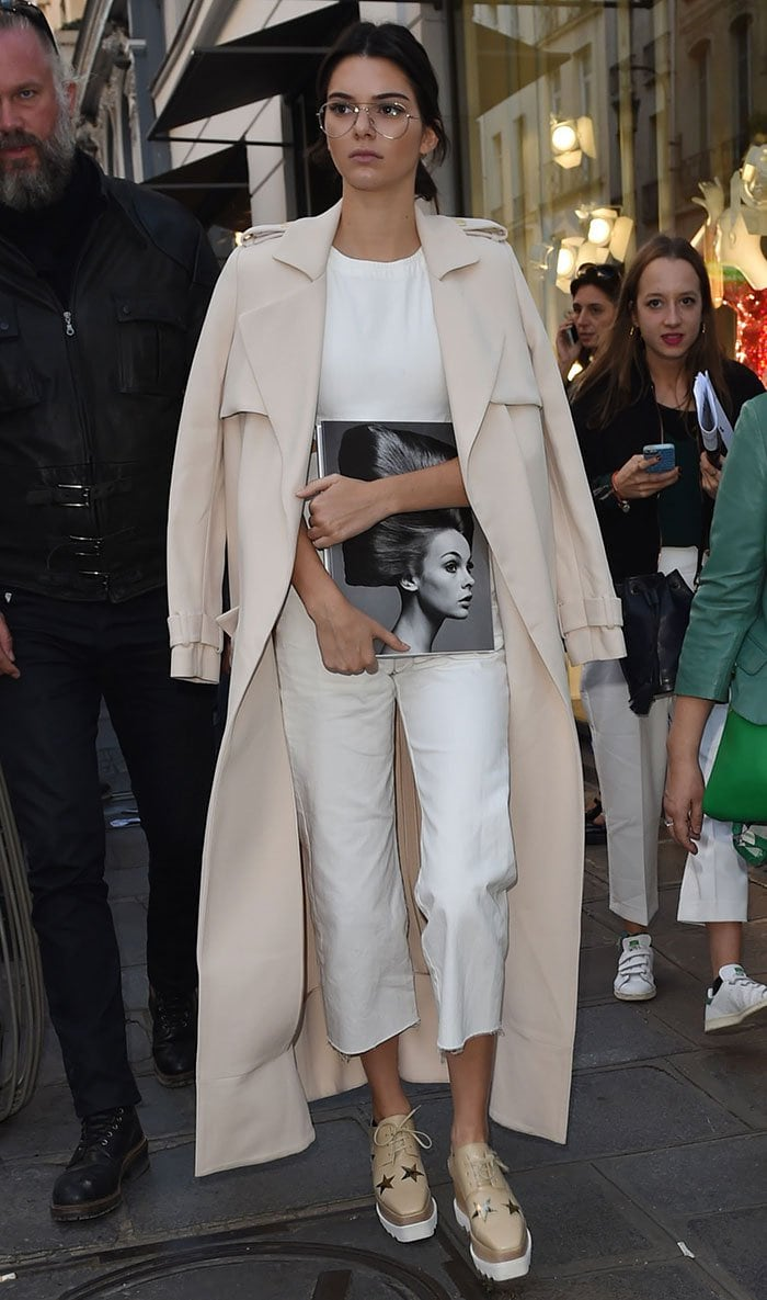 Kendall Jenner wearing Garrett Leight glasses and a white Asos jumpsuit