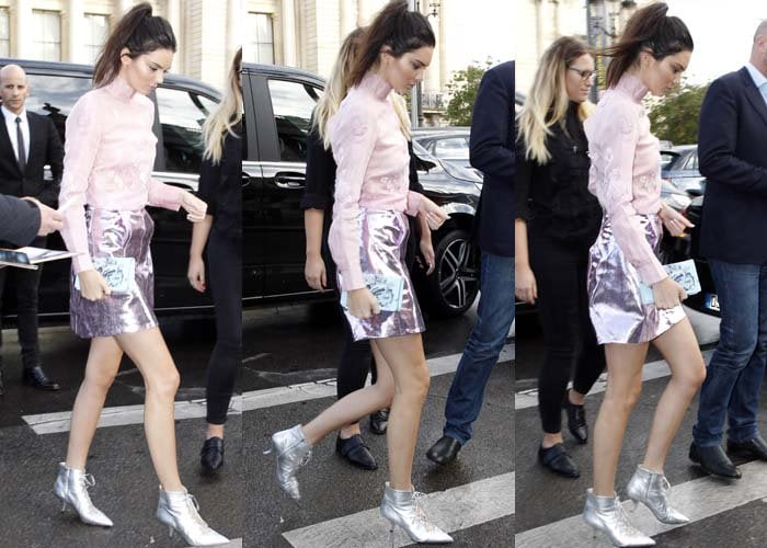 Kendall wore a metallic look from the Shiatzy Chen Autumn/Winter 2015 collection, pairing a feminine pink blouse with a metallic skirt and silver lace-up heels