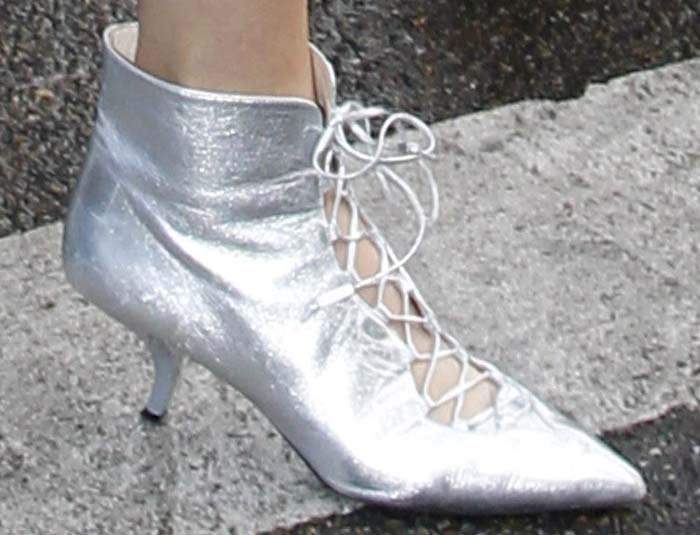 Kendall Jenner wearing silver lace-up heels