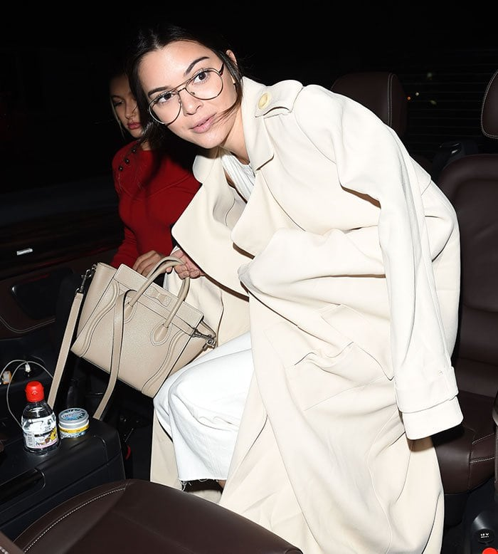 Kendall Jenner styled her hair in a loose ponytail before leaving the Colette bookstore
