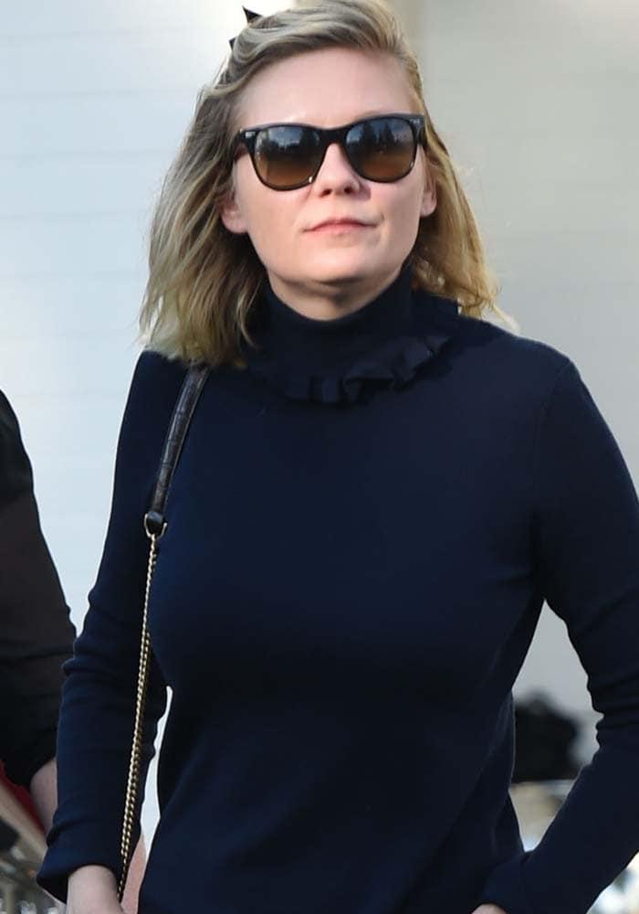 Kirsten Dunst wore a black turtleneck top