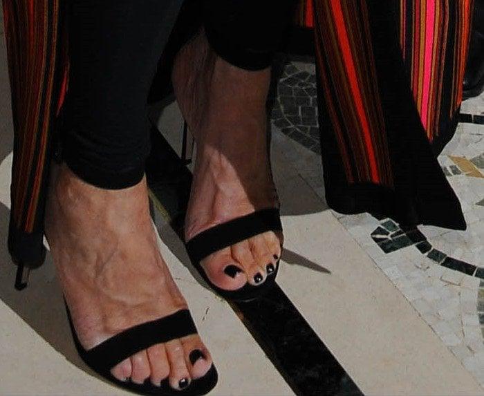 Kris Jenner shows off her feet in black sandals