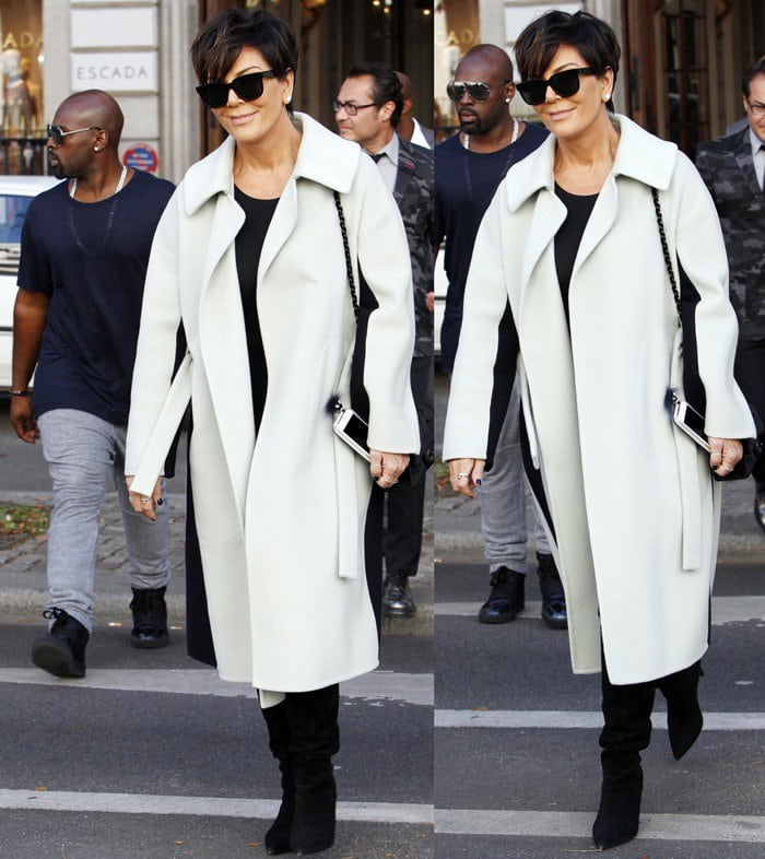 Kris Jenner sported an oversized woolen winter coat featuring a large collar and two vertical black stripes on either side