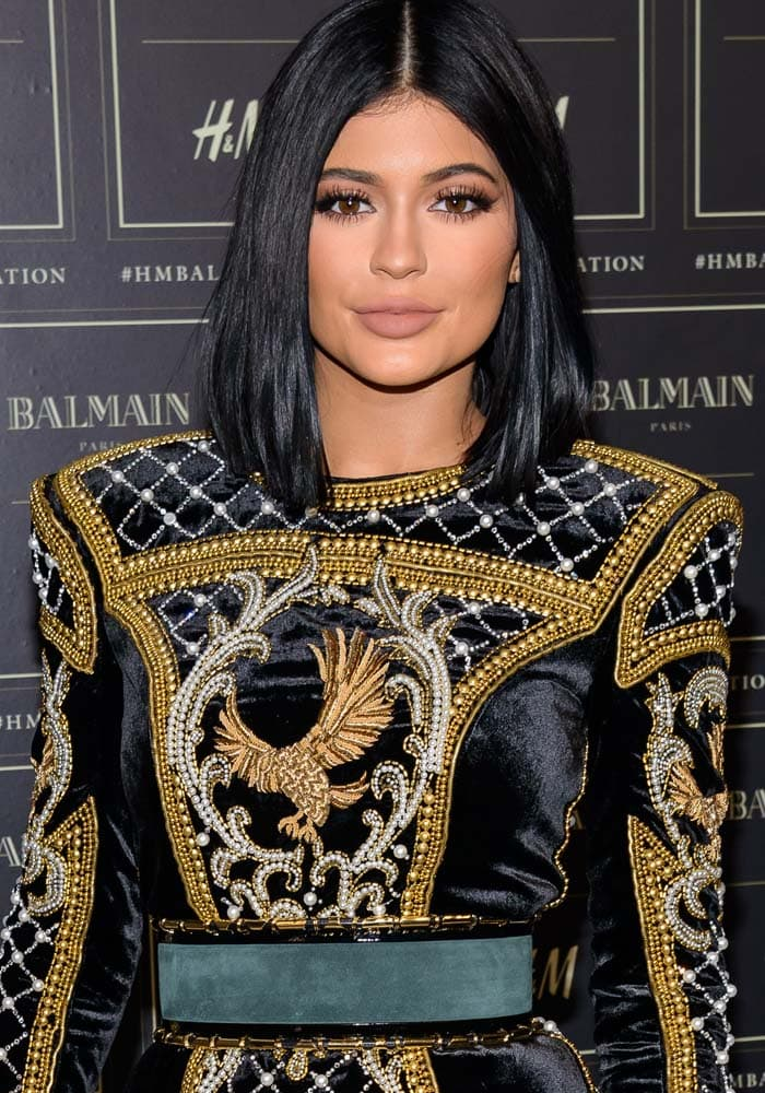 Kylie Jenner wore her hair with a center part at the Balmain x H&M collection launch