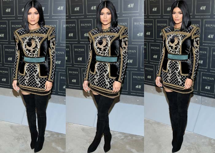 Kylie Jenner pairs an H&M x Balmain dress with a pair of Balmain boots at the launch of the H&M x Balmain collection