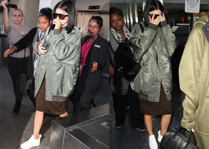 Kylie Jenner strolls through LAX in a Topshop dress and an R13 jacket