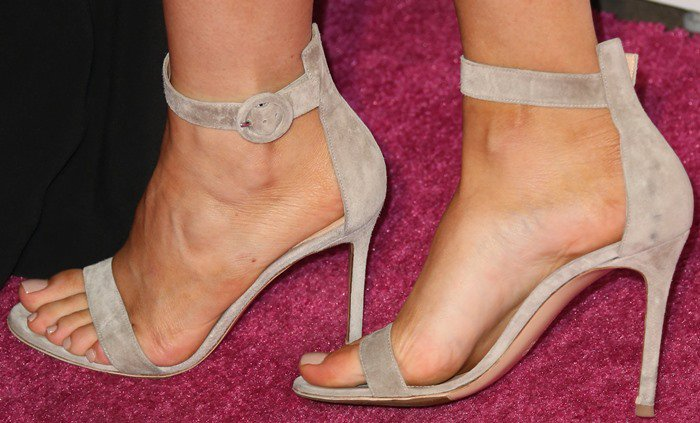 Kylie Jenner shows off her feet inbeige ankle-strap sandals from Gianvito Rossi