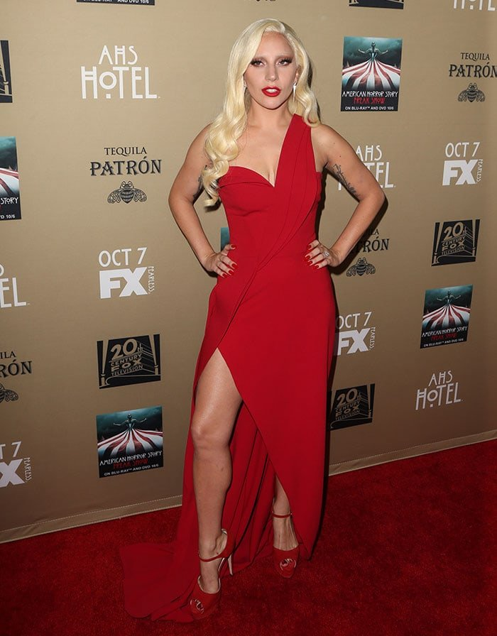 Lady Gaga wore a Brandon Maxwell Spring 2016 one-shoulder dress featuring a cleavage-baring low-cut neckline and a thigh-high slit that exposed her leg